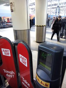 Advertisements on the ticket barriers of Waterloo Station, London, UK